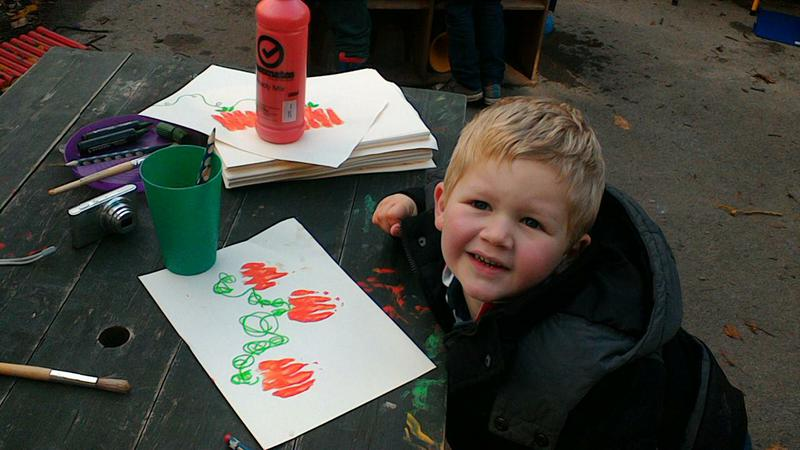 We made pumpkin pictures by painting our fingers.