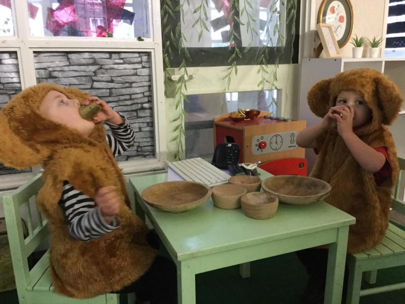 The 2 bears have a tea party.