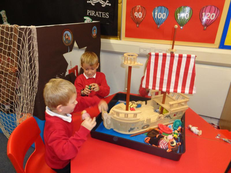 We love to act out stories using the small world!