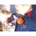 Hammering tees into a pumpkin!