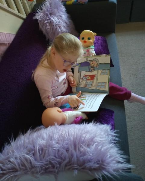 Reading to my dolls
