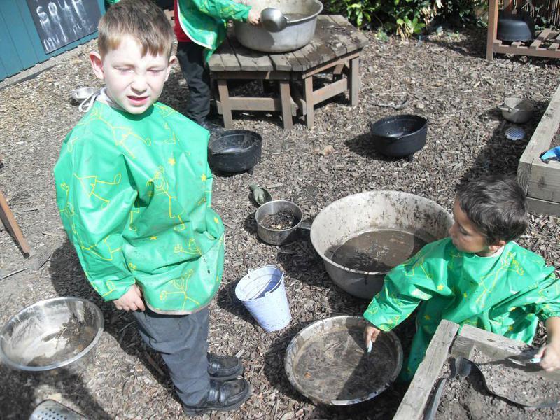 Exploring the mud kitchen