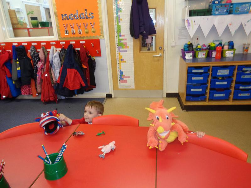 We are telling stories using puppets.