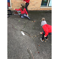 Creating tree and nature sculptures outside in groups.