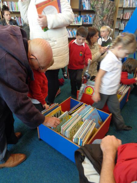 The children got to choose books to take home.