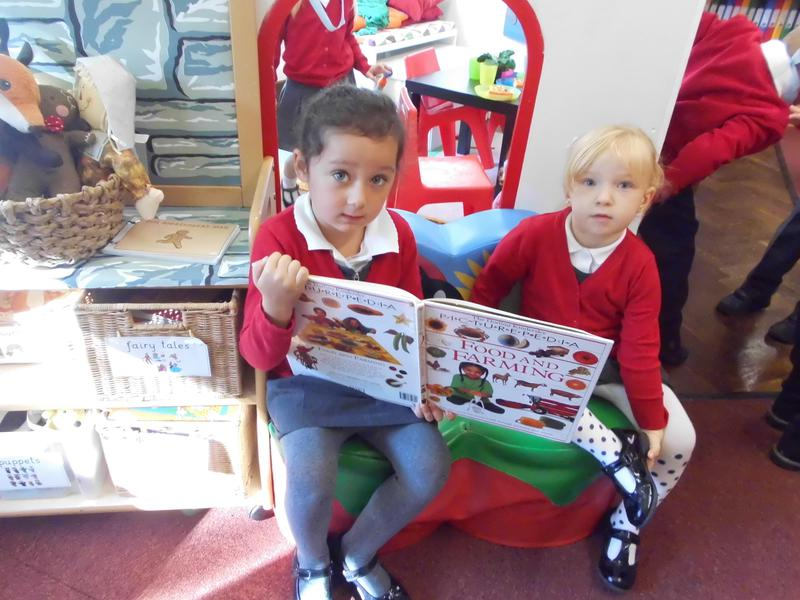 Sharing a book together in our Book Area