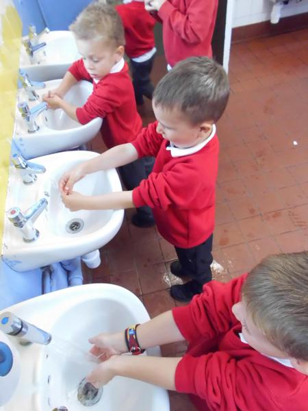 Washing our hands with warm water and soap