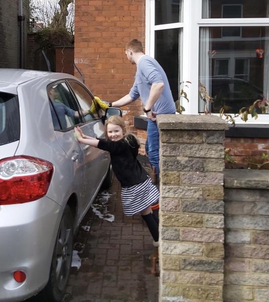 Helping Daddy wash the car 🚗