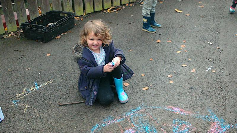Making a chalk picture.