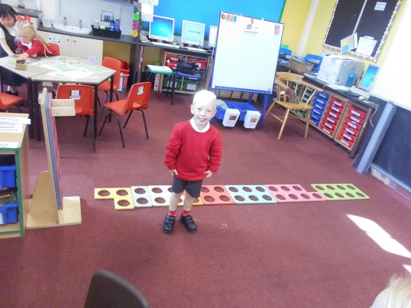 Laying out our giant Numicon tiles.