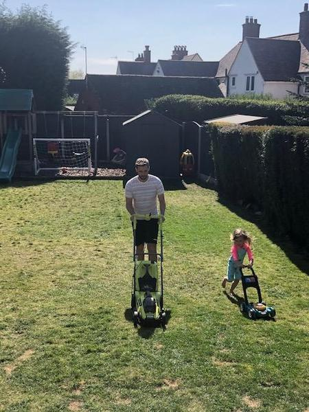 Helping Daddy mow the lawn.