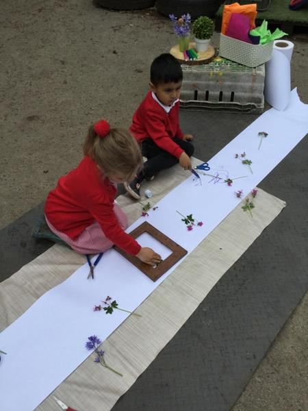 Creating with flowers, scissors and glue.