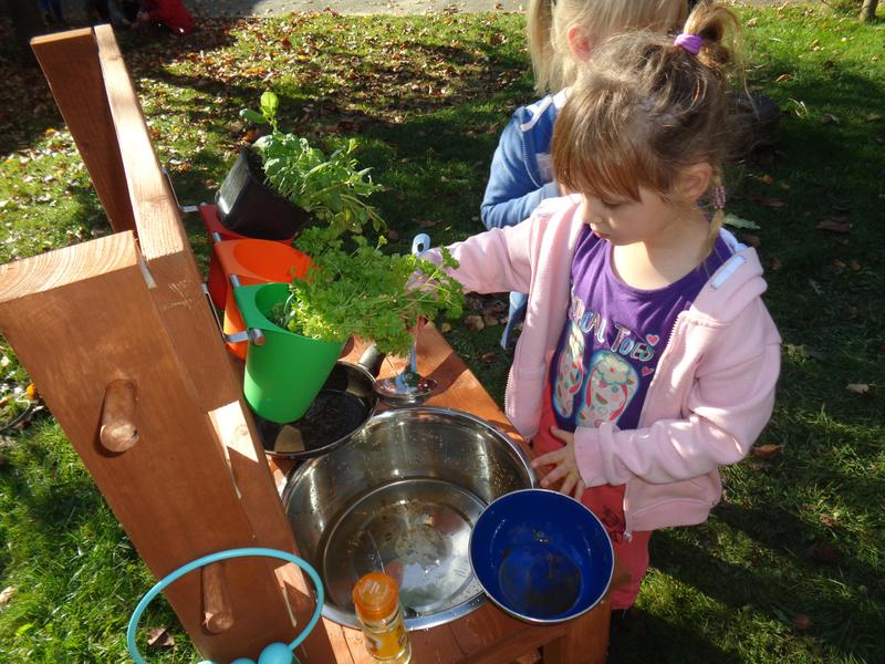 Making a 'smell' potion in our new mud kitchen