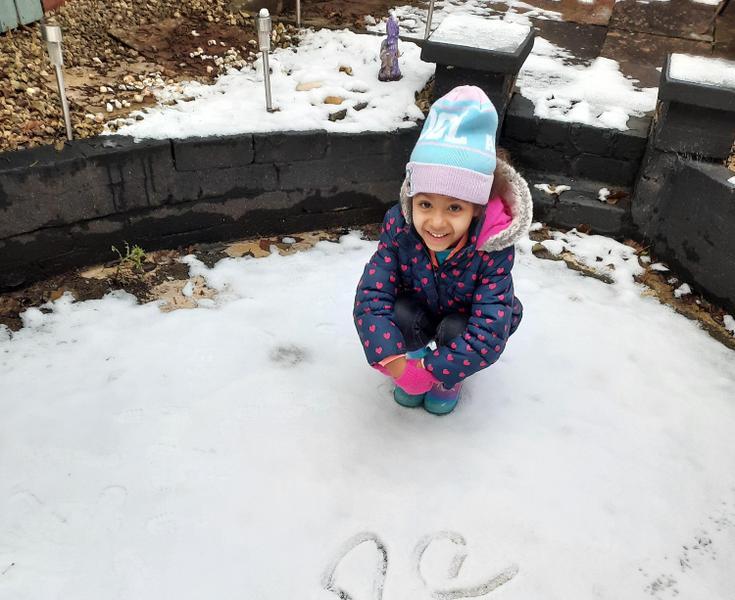Having fun writing in the snow.