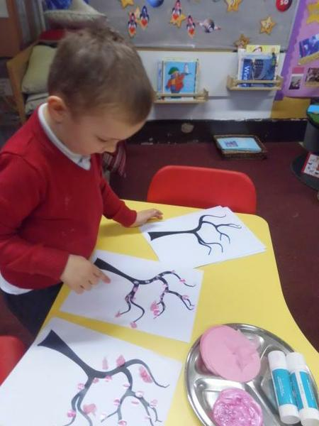 Finger painting our own blossom trees.