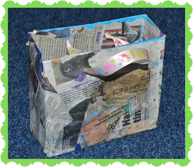 Milo from Squirrels decorated a box with newspaper