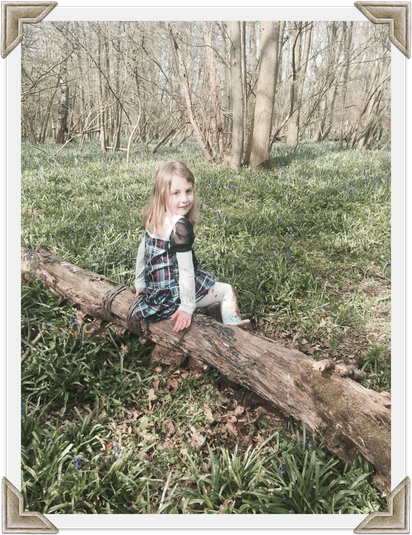 Jessica from Otter Class resting in bluebell woods