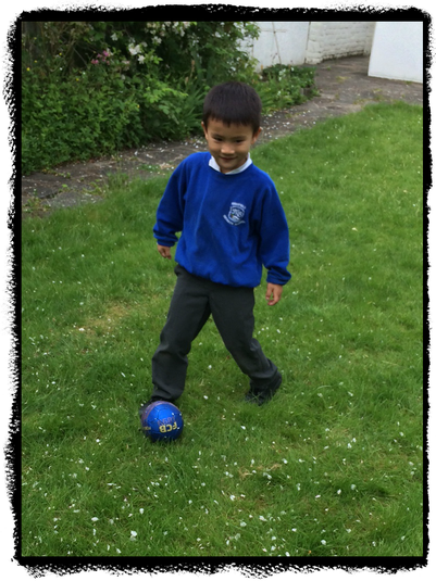 Marcus in Squirrel Class enjoys playing football