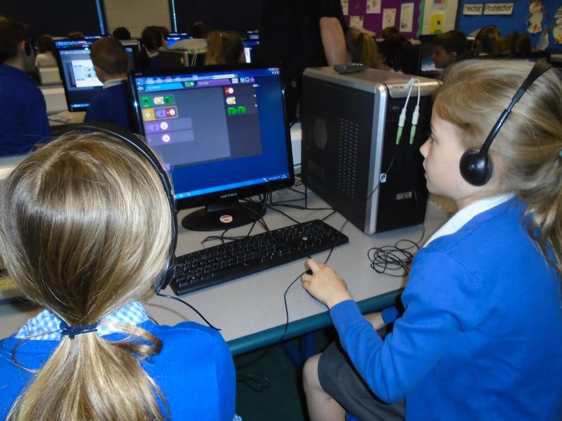 Learning coding with a partner.
