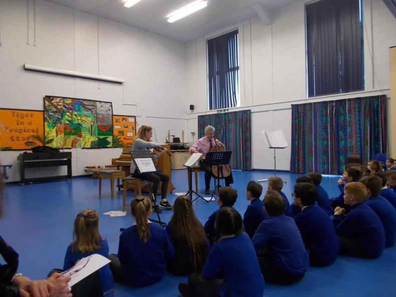 Key Stage 2 children enjoy the music of a trio from the Barbicon.