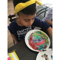 Ayaan doing some plate painting (3or)