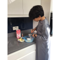 Umar helping his Auntie make Rainbow Cake (3or)