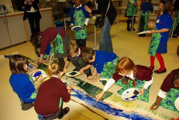 Group A painting the river bed