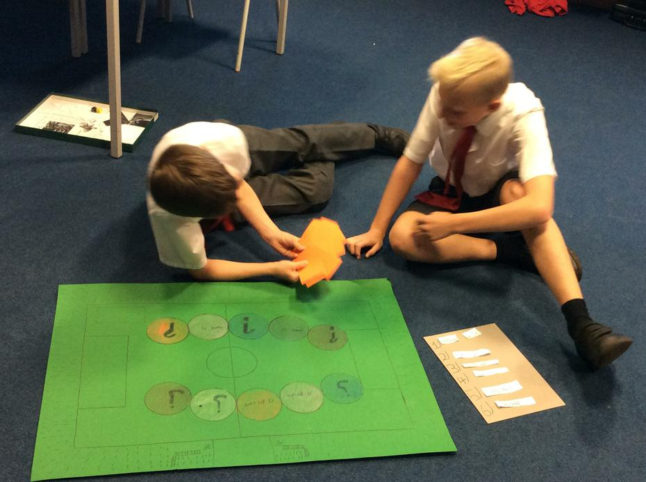 Playing their finished board games!