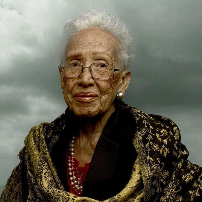 A dignified studio portrait of Katherine Johnson in later life.