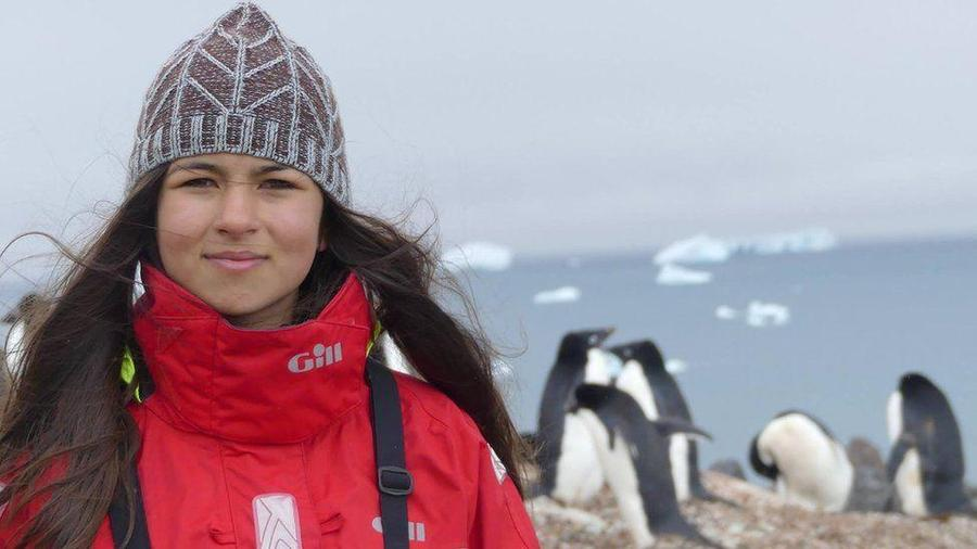 Maya Rose with penguins and ice floes in the background