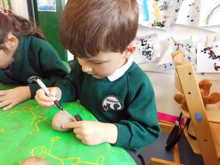 paint to decorate pebbles.
