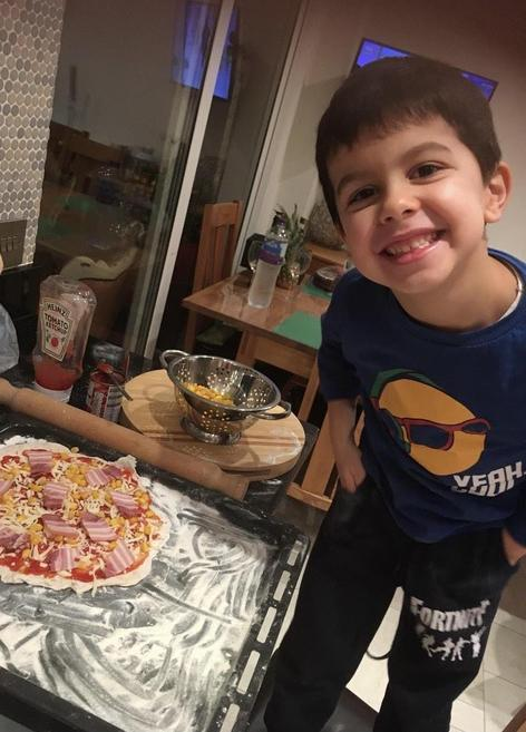 David has been busy making pizza for his families dinner!