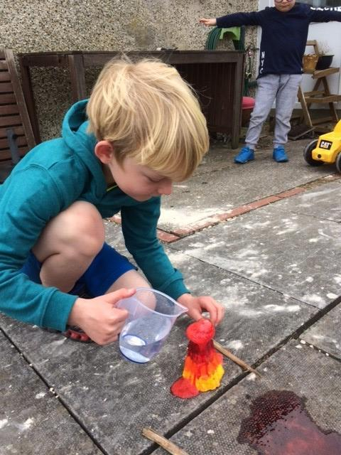 Building a volcano and creating explosions.