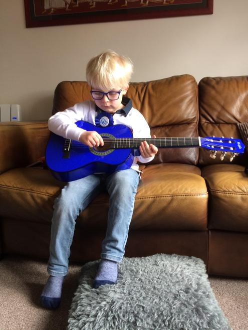 R had a guitar for his birthday