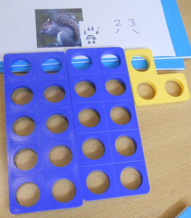 Numicon - physically representing place value