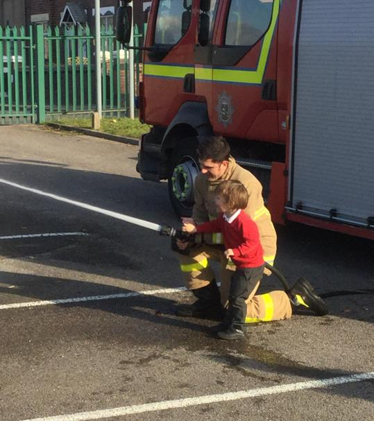 Enjoying a visit from the firefighters