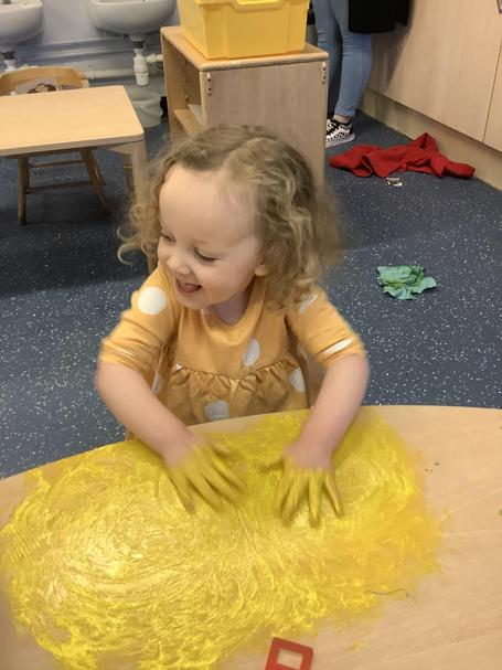 Getting stuck in to the finger paint