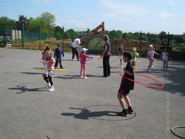 The hula hooping activity - deceptively difficult.