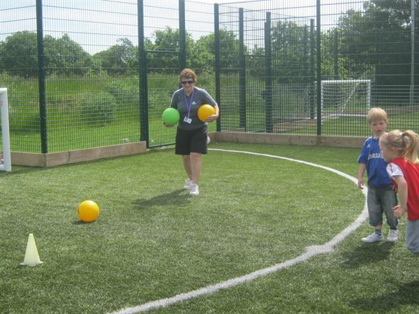 Mrs North's turn to set the footballs.