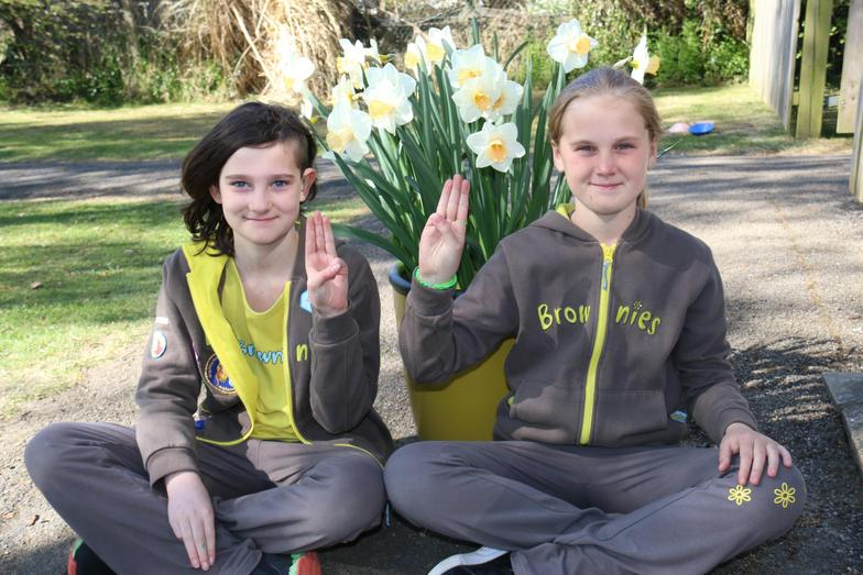 Connie and Sophie celebrating St George's Day in their Brownie uniforms