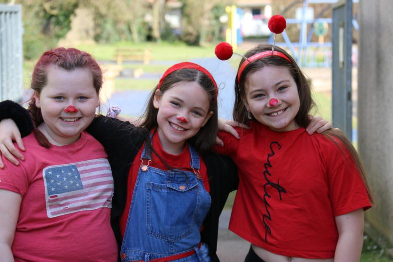 Three happy little red noses