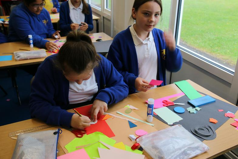 We had fun using different colour card to make a collage.