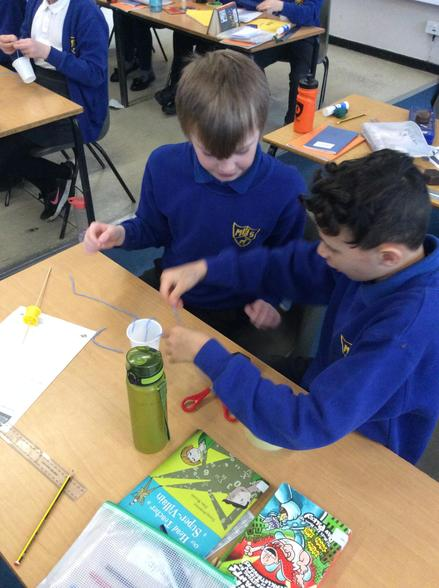 In Science we made pulleys to lift a weight.