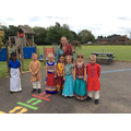 Pupils and Miss Palmer wearing Indian clothing