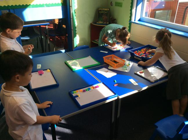 Pupils word building woth magnetic letters