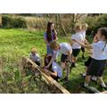 Year 6 build bug hotels in the school garden.