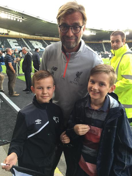 One of our children and Jurgen Klopp.