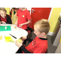 Y3 peeling and  chopping apples for their roman cake.