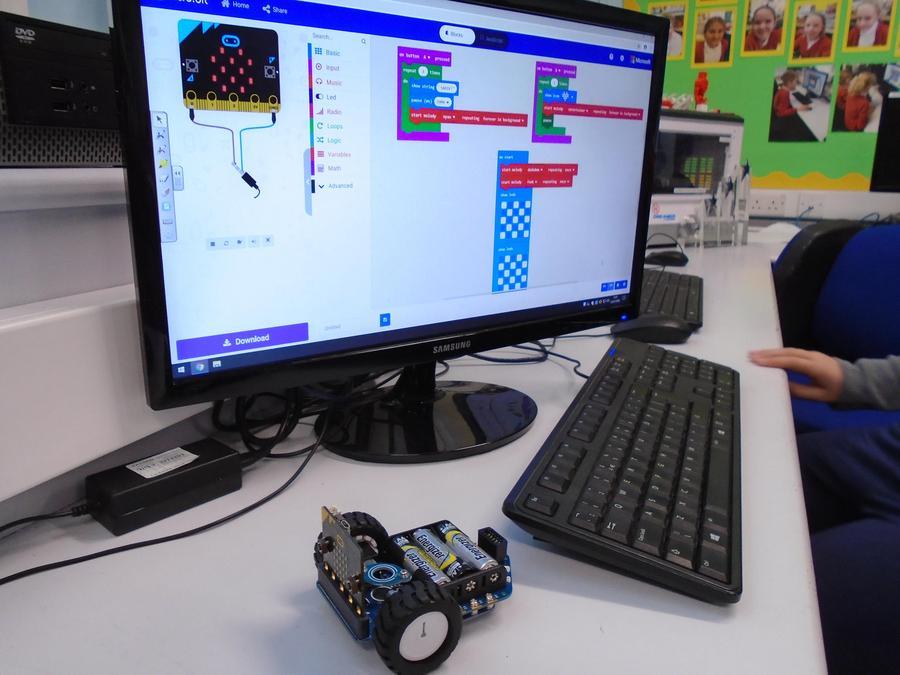RoboClub enjoying programming MiniBit Robots