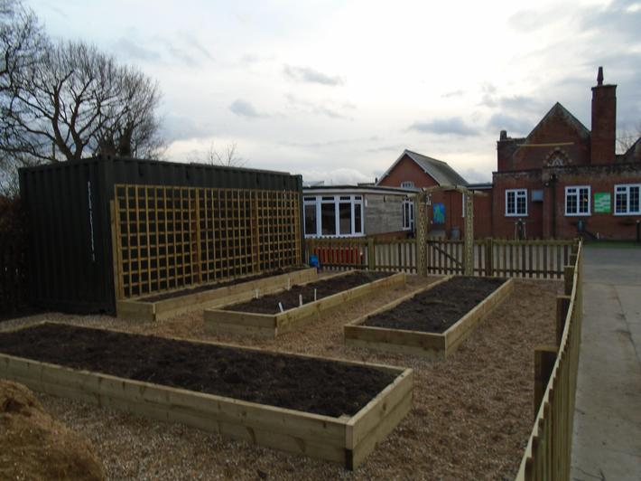 Four raised beds to grow produce for the school.